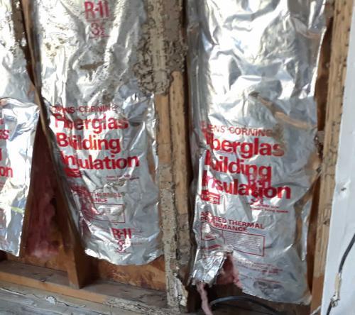 Xterminator Services job Termite damage behind wall on studs